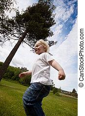Boy Running Outside