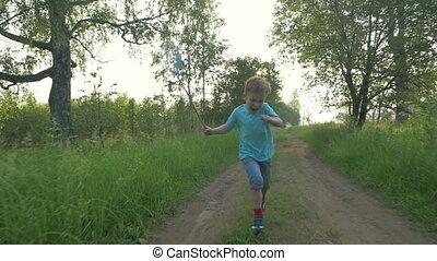 Boy Running with Scoop-Net - Steadicam shot of a little boy...