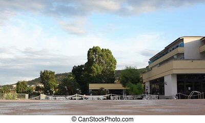 Boy runs and jumps into the pool, man did the same after him