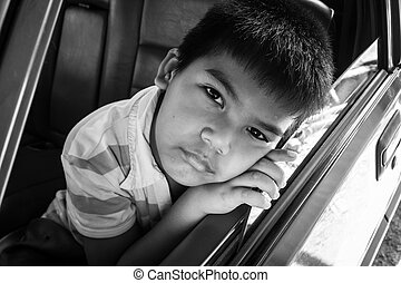 boy sad alone in the old car, black and white tone