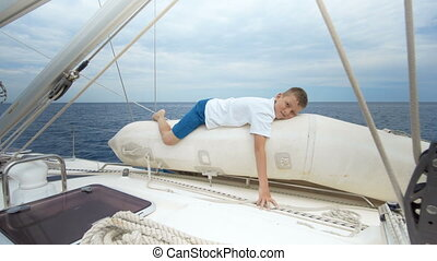 Boy sailing in a sea