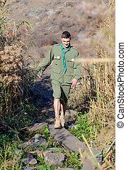 Boy Scout Testing Wood Plank Footbridge