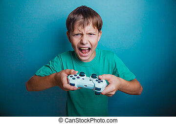 boy screaming open mouth holds the emotions game joystick on...