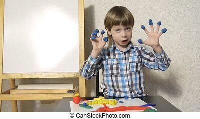 boy sculpts from plasticine - Blond boy sculpts from...
