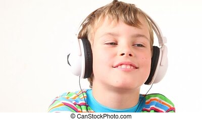 boy shake his head in earphones - happy boy in multicoloured...