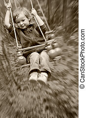 boy shakes on a swing