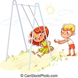 Boy shakes the girl on a swing at the playground