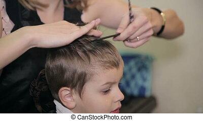 Boy shearing scissors