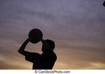 boy shooting basketball silhouette