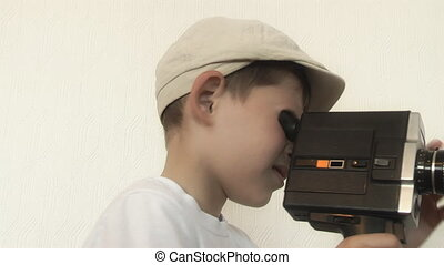Boy shoots a film movie camera - Boy shoots a film on 8mm...