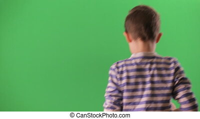 Boy shoots video on the smartphone. Green screen, chroma key