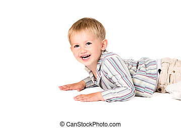 Boy shot in the studio on a white background laying smiling