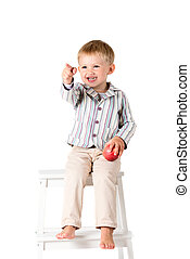 Boy shot in the studio on a white background pointing