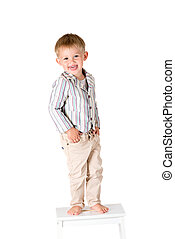 Boy shot in the studio on a white background showing tongue