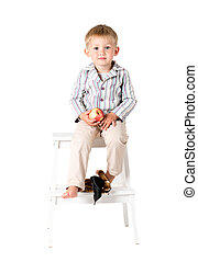 Boy shot in the studio on a white background toy