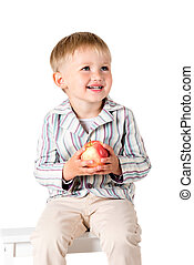 Boy shot in the studio on a white background with apple