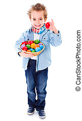 Boy showing an red Easter egg