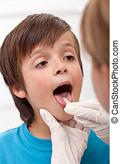 Boy showing her throat to health professional