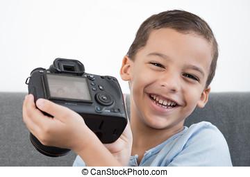 Boy showing photo on camera