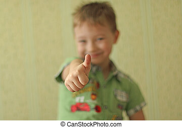 Boy showing thumbs up