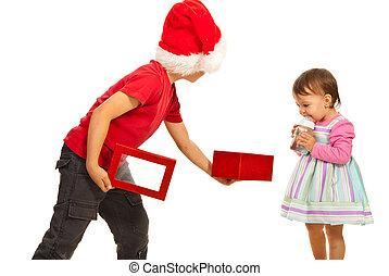 Boy showing to girl open box