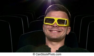 boy sitting at cinema, Close up. 3D stereo glasses. comedy Film