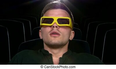boy sitting at cinema, Close up. 3D stereo glasses