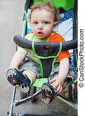 boy sitting in stroller