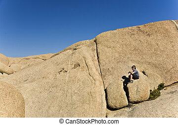 boy sitting on a rock - boy sitting on a big rock