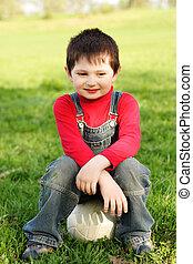 Boy sitting on ball