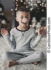 Boy sitting on floor and having a fun