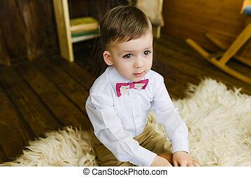 Boy sitting on fur