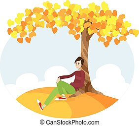Boy sitting under the tree