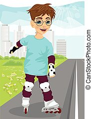 boy skating on rollerblades on sidewalk along the road - boy...