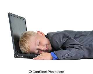 Boy sleeping on laptop tired of work