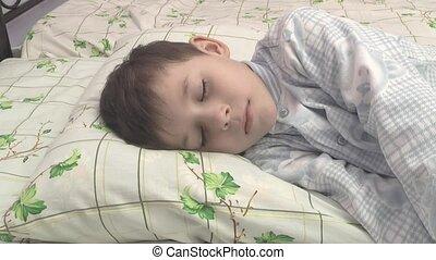 boy sleeps in the nursery.