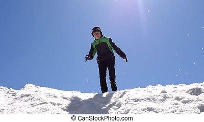 Boy sliding on the snow