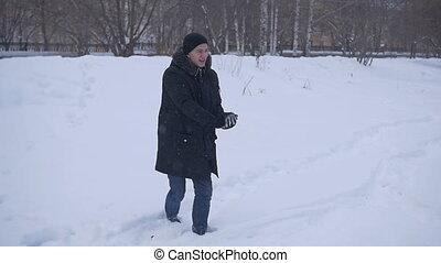 Boy smiling throwing snow