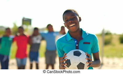 Boy smiling while looking at camera 4k