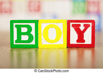 Boy Spelled Out in Alphabet Building Blocks