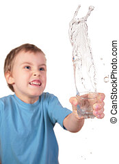 boy spills water from glass