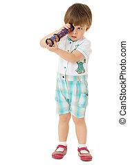 Boy spinning Kaleidoscope - The little boy looks through the...
