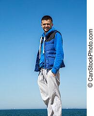 boy sportswear on sea background