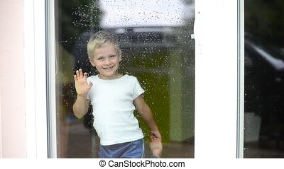 boy staing inside house - boy staying inside house while...