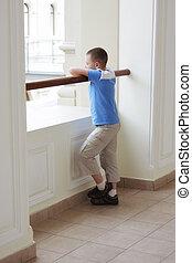 Boy standing alone