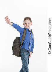 boy standing and waving hand on white. cute school boy...