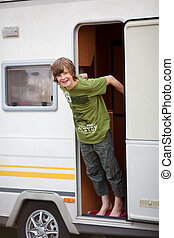 Boy Standing At Caravan Entrance
