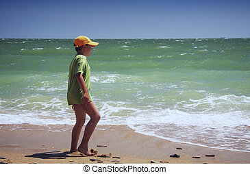 Boy standing at sea