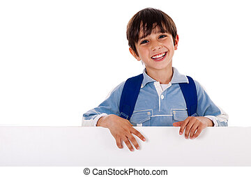 Young school kid standing behind the blank board isolated on white background