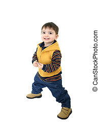 Boy Standing - Boy in yellow jacket and jeans standing on...